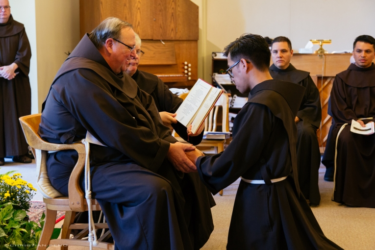 Me professing first vows into the hands of my provincial minister, Fr. Kevin Mullen