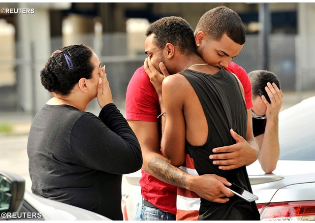 Friends and family members of victims embrace outside the Orlando Police Headquarters during the investigation of a shooting at the Pulse nightclub - REUTERS. From http://en.radiovaticana.va/news/2016/06/12/pope_francis_decries_orlando_massacre_and_prays_for_victims/1236740