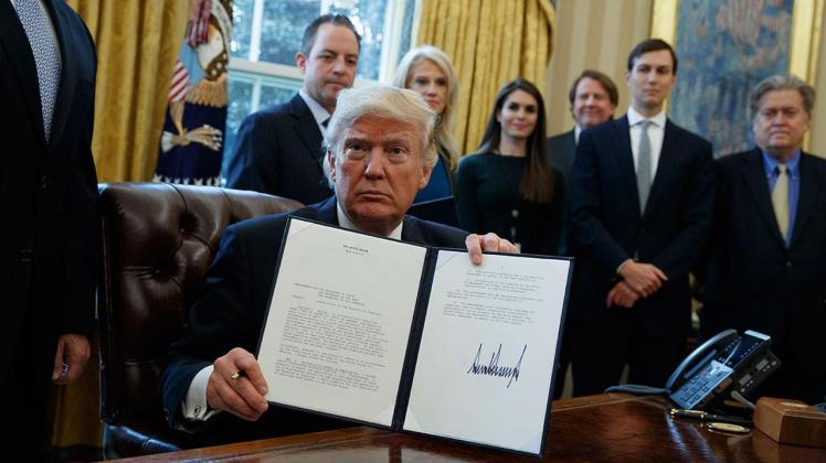 President Donald Trump shows his signature on an executive order on the Keystone XL pipeline, Tuesday, Jan. 24, 2017 (AP Photo/Evan Vucci). From http://abc30.com/politics/trump-signs-executive-actions-to-advance-keystone-dakota-pipelines/1718312/